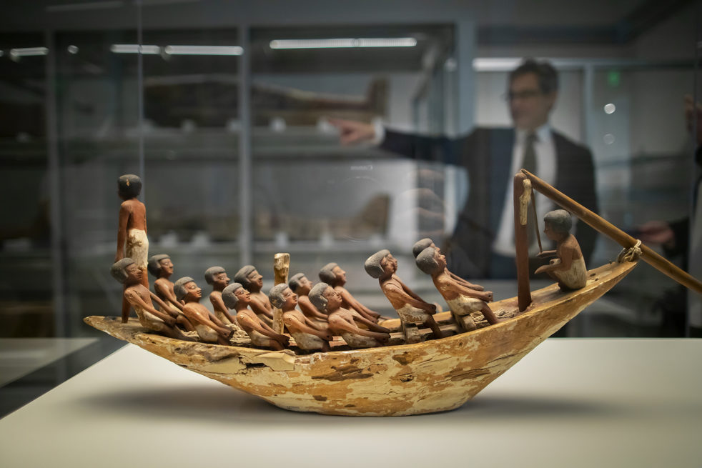 A new Penn Museum exhibition showcases 200 artifacts from its vast Egyptian collection, as well as their conservation, including a 4,000-year-old model of a rowing boat featuring 16 figures.